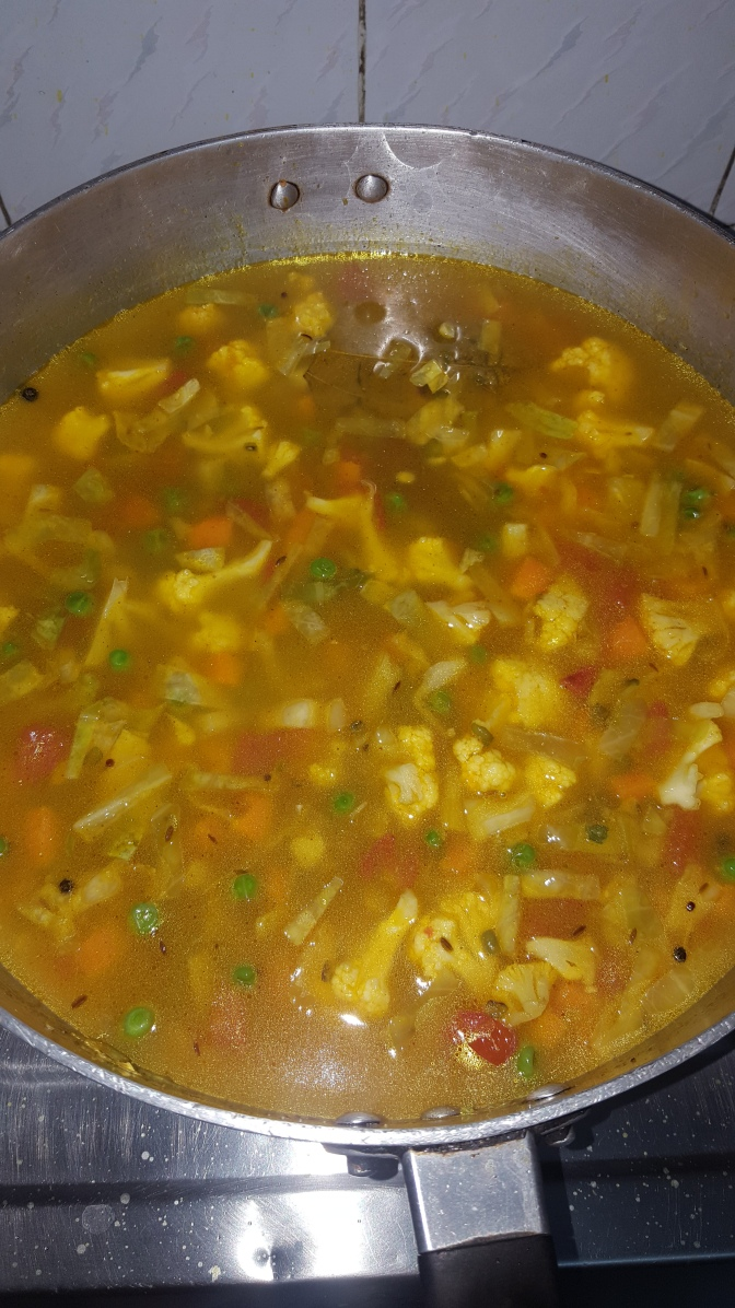 Add the soaked Split green dal and Khichdi rice, Please note for 1.5 cups Add 5 cups of water