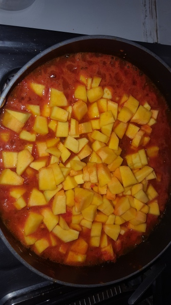 After adding the masalas add the chopped butternut