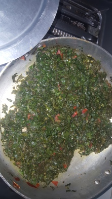 Heat oil and add tomatoes, once the tomatoes cook add the greens and mix, once the greens shrink add salt and mix well, let it cook for about 10 minutes