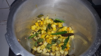 Add the cut potatoes and curry leaves. Let it cook for 5mins after adding salt and turmeric powder