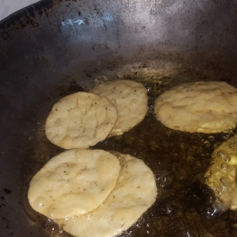 After putting the puris, fry on a medium Low flame