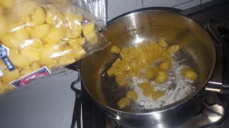 After the water boils, add pasta