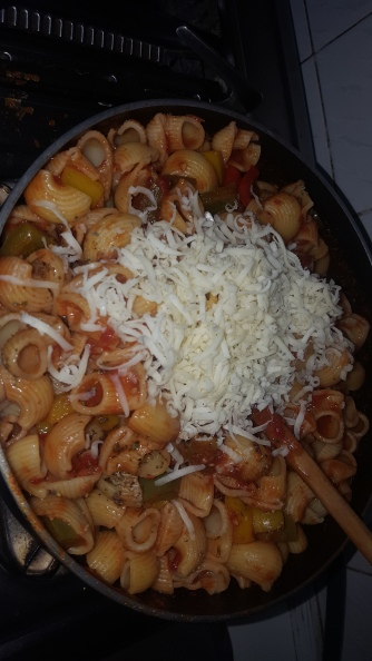 While in the pan add grated cheese and mix