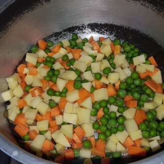 Once its aromatic add the chopped vegetables and salt, let it cook for a while