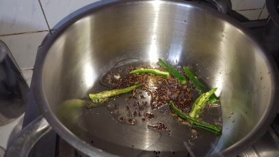 Heat Oil and add cumin seeds, green chillies and mustard