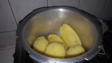 Boil Peeled poatoes in a cooker for 4 whistles
