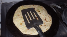 Flip it again and cook with a spatula, slowly press making sure its well cooked