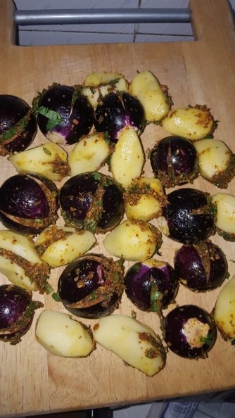 Make sure the brinjals are not fully cut, they should be cut just below half way for the stuffing to be filled